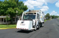 photo of waste vehicle for picking up solid waste